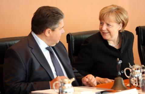 Il Ministro tedesco dell'Economia Sigmar Gabriel e la cancelliera Angela Merkel (Adam Berry/Getty Images)