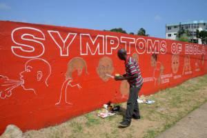 Un murales con la descrizione dei sintomi del virus Ebola, Monrovia, Liberia (DOMINIQUE FAGET/AFP/Getty Images)