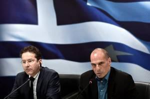 Il presidente dell'Eurogruppo Jeroen Dijsselbloem e il ministro delle Finanze greco Yanis Varoufakis (ARIS MESSINIS/AFP/Getty Images)