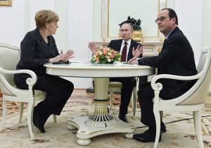 Merkel Putin Holland Mosca Ucraina
