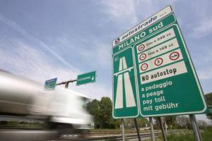 Milan, ITALY:  (FILES) - A truck enters in Milan on A1 highway in direction of Naples, 24 April 2006. Italian motorway group Autostrade and Abertis of Spain have abandoned a planned merger, which would have created the world's biggest highway operator, they said, 13 DECEMBER 2006, but hoped to revive the plan at some point. AFP PHOTO / PACO SERINELLI  (Photo credit should read PACO SERINELLI/AFP/Getty Images)