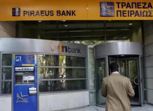 A man enters a branch of the Piraeus Ban