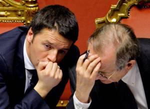 Renzi e Padoan (ANDREAS SOLARO/AFP/Getty Images)