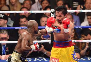 Floyd Mayweather-Manny Pacquiao (Photo credit should read FREDERIC J. BROWN/AFP/Getty Images)