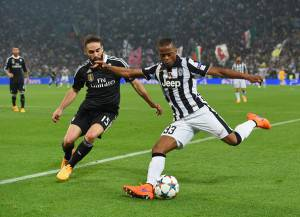 TURIN, ENGLAND - MAY 05:  Patrice Evra of Juventus takes on Daniel Carvajal of Real Madrid CF during the UEFA Champions League semi final first leg match between Juventus and Real Madrid CF at Juventus Arena on May 5, 2015 in Turin, Italy.  (Photo by Michael Regan/Getty Images)