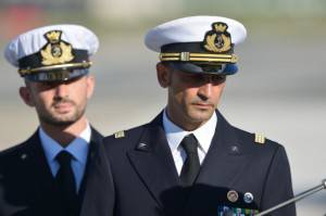 Italian marines Massimiliano Latorre ( R ) and Salvatore Girone ( L ) arrive at Ciampino airport near Rome, on December 22, 2012.An Indian court allowed two Italian marines awaiting trial for shooting two fishermen to go home for Christmas, despite prosecution fears that they will not return. The marines shot dead the fishermen off India's southwestern coast near the port city of Kochi in February while guarding an Italian oil tanker, but they deny murder on the grounds that they mistook their victims for pirates. AFP PHOTO/ VINCENZO PINTO        (Photo credit should read VINCENZO PINTO/AFP/Getty Images)