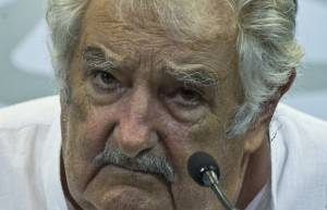 Uruguay's President Jose Mujica listens journalists questions after signing agreements with his Bolivian counterpart Evo Morales (out of frame) in Montevideo on February 26, 2015, two days before newly elected leftist president Tabare Vazquez assumes office, succeeding Mujica. AFP PHOTO / Pablo PORCIUNCULA        (Photo credit should read PABLO PORCIUNCULA/AFP/Getty Images)