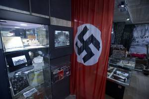 View of the World War II exhibit, featuring a large Swastika, in the Berlin Story bunker close to the former Anhalter railway station in Berlin April 13, 2015. The bunker, built over 10 months in 1943 to serve as an air raid shelter, houses a museum about the city of Berlin through the ages.  AFP PHOTO / JOHN MACDOUGALL        (Photo credit should read JOHN MACDOUGALL/AFP/Getty Images)