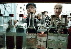 "Moscow, RUSSIAN FEDERATION:  TO GO WITH AFP STORY BY VICTORIA LOGUINOVA This undated file picture, shows Russians purchasing vodka from a street kiosk in Moscow. A reform aimed at protecting Russian consumers from substandard alcohol is turning Russia into a country where even vodka, the nation's drink of choice, is becoming scarce, experts warned. ""Russia could become a country without alcohol by September,"" said Boris Titov, head of the trade association Business Russia. AFP PHOTO  ALEXANDER NEMENOV  (Photo credit should read ALEXANDER NEMENOV/AFP/Getty Images)"