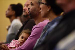 Tony LLorens holds his daughter Ruby (3) at the First AME Church of Los Angeles, California, June 18, 2015, during a multi-denominational prayer service in memory of the victims of the mass shooting at Emanuel AME Church in Charleston, S.C.   AFP PHOTO / ROBYN BECK        (Photo credit should read ROBYN BECK/AFP/Getty Images)