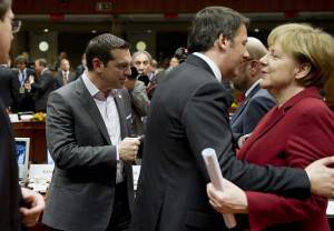Greek Prime Minister Alexis Tsipras (L) stands near his Italian counterpart Matteo Renzi as he greets German Chancellor Angela Merkel (R) head of a roundtable meeting during an EU Council summit at the EU headquarters in Brussels on March 19, 2015. AFP PHOTO / ALAIN JOCARD        (Photo credit should read ALAIN JOCARD/AFP/Getty Images)