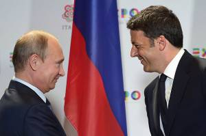 Russian President Vladimir Putin (L) shakes hands with Italian Prime Minister Matteo Renzi at the end of their press conference following a meeting and a visit at the Expo Milano 2015, the universal exhibition, on June 10, 2015 in Milan.  AFP PHOTO / OLIVIER MORIN        (Photo credit should read OLIVIER MORIN/AFP/Getty Images)