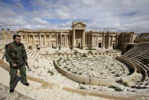 A picture taken on March 14, 2014 shows a Syrian policeman patrolling the ancient oasis city of Palmyra, 215 kilometres northeast of Damascus. From the 1st to the 2nd century, the art and architecture of Palmyra, standing at the crossroads of several civilizations, married Graeco-Roman techniques with local traditions and Persian influences. AFP PHOTO/JOSEPH EID        (Photo credit should read JOSEPH EID/AFP/Getty Images)
