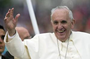 Pope Francis waves as he travels on the popemobile along the streets of Quito on July 5, 2015. Pope Francis arrived in Ecuador on Sunday to kick off his first South American trip in two years that will also take him to Bolivia and Paraguay and see him highlight the plight of the poor. AFP PHOTO/LUIS ROBAYO        (Photo credit should read LUIS ROBAYO/AFP/Getty Images)