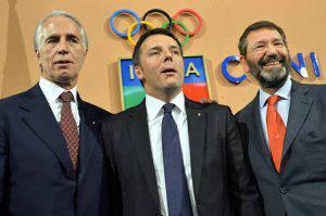 Renzi e Marino col presidente del Coni, Malagò (ANDREAS SOLARO/AFP/Getty Images)