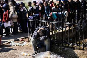 A migrant rests near  the police station in the southern Serbian town of Presevo, near the border with Macedonia, on July 2, 2015. Illegal immigrants cross Serbia on their way to other European countries as it has land access to three members of the 28-nation bloc -- Romania, Hungary and Croatia. This year, more than 50,000 migrants tried to cross into Hungary via Serbia between January 1 and May 31 -- representing an 880-percent increase compared to the same period in 2014, according to the EU's Frontex border agency. AFP PHOTO / DIMITAR DILKOFF        (Photo credit should read DIMITAR DILKOFF/AFP/Getty Images)