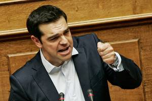 ATHENS, GREECE - JUNE 27:Greek Prime Minister Alexis Tsipras delivers a speech during a parliamentary session in Athens, Greece June 28, 2015 . Greece's fraught bailout talks with its creditors took a dramatic turn early Saturday, with the radical left government announcing a referendum in just over a week on the latest proposed deal . (Photo by Milos Bicanski/Getty Images)