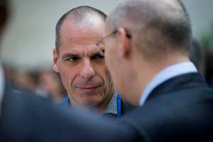 Yanis Varoufakis, Greece's finance minister, left, talks to Kairat Kelimbetov, governor of the National Bank of Kazakhstan, before an IMF governors' group photo during the International Monetary Fund (IMF) and World Bank Group Spring Meetings in Washington, D.C., U.S., on Saturday, April 18, 2015. IMF Managing Director Christine Lagarde warned this week that she wouldn't let Greece skip a debt payment to the lender, shutting down a potential avenue to buy the Greek government some financial leeway. Photographer: Andrew Harrer/Bloomberg via Getty Images