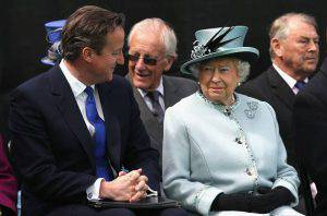 RUNNYMEDE, ENGLAND - JUNE 15:  Queen Elizabeth II chats to British Prime Minister David Cameron at a Magna Carta 800th Anniversary Commemoration Event on June 15, 2015 in Runnymede, United Kingdom. Members of the Royal Family are visiting Runnymede to attend an event commemorating the 800th anniversary of Magna Carta. Magna Carta is widely recognised as one of the most significant documents in history. Its influence, as a cornerstone of fundamental liberties, is felt around the world in the constitutions and political traditions of countless nations. (Photo by Chris Jackson - WPA Pool / Getty Images)