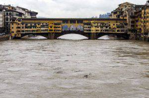 A picture shows the Ponte Vecchio bridge as the Arno river's water level rose following heavy rain in Florence on January 31, 2014.  AFP PHOTO / ANDREAS SOLARO        (Photo credit should read ANDREAS SOLARO/AFP/Getty Images)