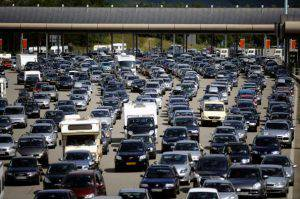 "Vehicles leave after queuing up at the ""Peage de Roussillon"" highway toll on the A7 motorway on July, 23, 2011 near Vienne, southeastern France. 400 km-long-traffic jams were reported at midday in France, among them 140 km in Rhone-Alpes region, on the way to the French Riviera and Italy. AFP PHOTO JEFF PACHOUD (Photo credit should read JEFF PACHOUD/AFP/Getty Images)"