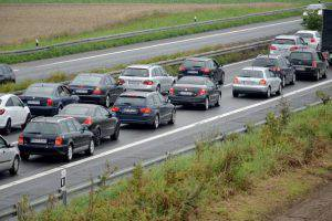 PFUNGSTADT, GERMANY - JULY 13:  Motorists sit in traffic in front of a full closure on the A5 motorway after a traffic accident July 13, 2014 near Pfungstadt, Germany.  (Photo by Thomas Lohnes/Getty Images)