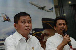 Indonesia's Transport Minister Ignasius Jonan (L) looks on as Director General for Air Transportation Suprasetyo (R) speaks during a press conference in Jakarta on August 16, 2015, announcing that a missing plane carrying 54 people has crashed into a mountain in eastern Indonesian province of Papua. A passenger plane of Trigana Air carrying 54 people went missing on August 16, during a flight in bad weather in rugged eastern Indonesia, officials said, in what could be the latest accident to hit the country's aviation sector.  AFP PHOTO / ROMEO GACAD        (Photo credit should read ROMEO GACAD/AFP/Getty Images)