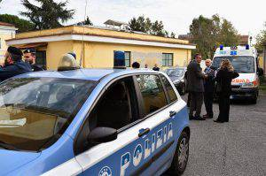 People stand next to police cars at the main entrance of the Lazzaro Spallanzani Institute in Rome on November 25, 2014. A doctor, 50-years old from Sicily whose first name was reported to be Fabrizio, the first Italian to contract the Ebola virus, arrived in Rome from Sierra Leone, where he was working for the charity Emergency at a clinic for Ebola victims, for specialist treatment in an infectious diseases hospital. AFP PHOTO / GABRIEL BOUYS (Photo credit should read GABRIEL BOUYS/AFP/Getty Images)