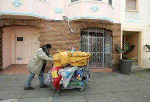 SAN FRANCISCO - FEBRUARY 28: Joseph Cappa, a homeless person, pushes his shopping cart through a residential neighborhood February 28, 2007 in San Francisco, California. According to a report by the Department of Housing and Urban Development, there are over 750,000 homeless people that live on the streets, shelters and transitional housing throughout the United States. (Photo by Justin Sullivan/Getty Images)