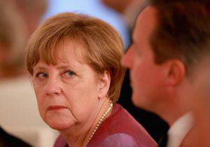 BERLIN, GERMANY - JUNE 24: Angela Merkel glances at British Prime Minister David Cameron during a State Banquet at the Schloss Bellevue Palace on the second day of a four day State Visit on June 24, 2015 in Berlin, Germany. (Photo by Chris Jackson - WPA Rota/Getty Images)