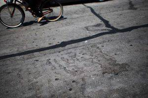 ISLA VISTA , CA - MAY 25:  The outline of a blood stain that was cleaned up remains on the street at a crime scene May 25, 2014 in Isla Vista, California. According to reports, 22 year old Elliot Rodger, son of assistant director of the Hunger Games, Peter Rodger, began his mass killing near the University of California in Santa Babara by stabbing three people to death in an apartment. He then went on to shooting people while driving his BMW and ran down at least one person until crashing with a self-inflicted gunshot wound to the head. Officers found three legally-purchased guns registered to him inside the vehicle. Prior to the murders, Rodger posted YouTube videos declaring his intention to annihilate the girls who rejected him sexually and others in retaliation for his remaining a virgin at age 22. Seven people died, including Rodger, and seven others wounded, according to authorities. (Photo by David McNew/Getty Images)