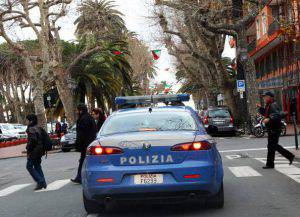 TO GO WITH AFP STORY BY CATHERINE MARCIANO An Italian police car patrols in the streets of Ventimiglia, in northwestern Italy, near the French border, on February 21, 2012. The town's municipal council was sacked in February after several months of investigation revealed their alledged ties to the N'Drangheta, the Calabrian Mafia, which has used local businesses in various ways to funnel money from organized crime. AFP PHOTO / VALERY HACHE (Photo credit should read VALERY HACHE/AFP/Getty Images)