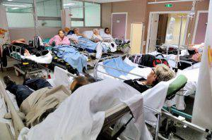 Patients wait in the emergency room of a hospital in Lens, northern France, on September 18, 2013. AFP PHOTO / PHILIPPE HUGUEN (Photo credit should read PHILIPPE HUGUEN/AFP/Getty Images)