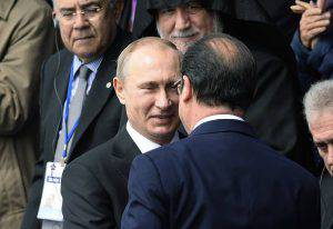 Russian President Vladimir Putin (L) speaks with French President Francois Hollande attend a ceremony at the Genocide Memorial in Yerevan on April 24, 2015. The leaders of France and Russia joined ceremonies marking the centenary of the massacre of some 1.5 million Armenians by Ottoman forces, a hugely emotional event that remains a diplomatic minefield. AFP PHOTO / ALAIN JOCARD (Photo credit should read ALAIN JOCARD/AFP/Getty Images)