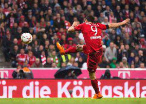 MUNICH, GERMANY - SEPTEMBER 22: Robert Lewandowski of Bayern Munich scores his 4th goal during the Bundesliga match between FC Bayern Muenchen and VfL Wolfsburg at Allianz Arena on September 22, 2015 in Munich, Germany. (Photo by A. Pretty/Getty Images for FC Bayern)