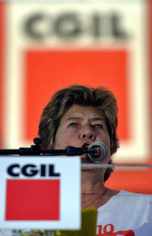 Italian General Confederation of Labour union (CGIL) leader Susanna Camusso talks to demonstrators during a rally organised by the union on October 25, 2014 in central Rome as part of a nationwide protest called to protest Prime Minister Matteo Renzi's plans to overhaul the labour market. AFP PHOTO/ Filippo MONTEFORTE (Photo credit should read FILIPPO MONTEFORTE/AFP/Getty Images)