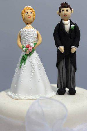 LONDON, ENGLAND - FEBRUARY 22: Figurines and displayed on a cake during the National Wedding Show at London's Olympia on February 22, 2013 in London, England. The National Wedding Show runs at London's Olympia until February 24 and features over 250 trade stands selling everything from wedding dresses, suits, cakes, shoes and flowers. (Photo by Dan Kitwood/Getty Images)