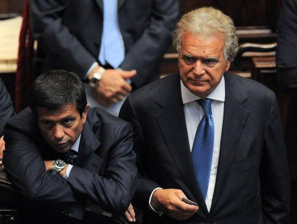 A destra, Denis Verdini (ANDREAS SOLARO/AFP/Getty Images)