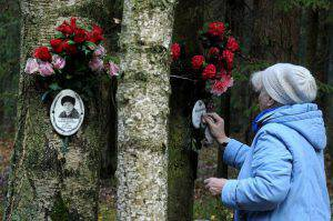 A woman cleans a plaque for a victim of Soviet dictator Joseph Stalin's purges at the memorial, where the victims were buried in the woods on the outskirts of St. Petersburg, on October 30, 2015. Russia observed today Day of Victims of Political Repressions as people honored the memory of the thousands of victims perished in the repressions of the Soviet Communist regime. AFP PHOTO / OLGA MALTSEVA        (Photo credit should read OLGA MALTSEVA/AFP/Getty Images)