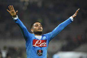 Napoli's Italian midfielder Lorenzo Insigne celebrates after scoring his second goal during the Italian Serie A football match between AC Milan and Napoli at San Siro Stadium in Milan on October 4,  2015. AFP PHOTO / OLIVIER MORIN        (Photo credit should read OLIVIER MORIN/AFP/Getty Images)