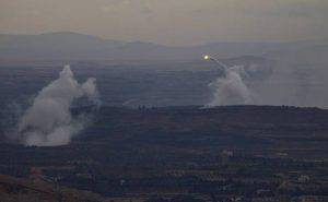 A picture taken from the hill village of Buqaata in the Israeli-annexed Syrian Golan Heights shows flames and smoke ascending from alleged shelling by Syrian government forces on Islamic State group's positions near the Syrian village of Jubata al-Khashab on October 6, 2015. AFP PHOTO / JALAA MAREY (Photo credit should read JALAA MAREY/AFP/Getty Images)