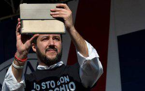 """Northern League party leader Matteo Salvini takes pictures as he helds a rally in Rome February 28, 2015. The leader of Italy's right-wing Lega Nord party, Matteo Salvini, held a protest against the policy of Prime Minister Matteo Renzi's government. At the same time, left-wing movements and associations held a """"Mai con Salvini"""" (Never with Salvini) counter-demonstration also in Rome.  AFP PHOTO / TIZIANA FABI        (Photo credit should read TIZIANA FABI/AFP/Getty Images)"""