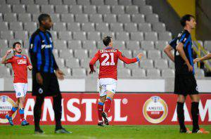 Napoli's Romanian defender Vlad Chiriches (C) celebrates after scoring a goal during a UEFA Europa League Group D football match between Club Brugge and SSC Napoli played behind closed doors at the Jan Breydel stadium in Bruges on November 26, 2015. AFP PHOTO / JOHN THYS / AFP / JOHN THYS (Photo credit should read JOHN THYS/AFP/Getty Images)