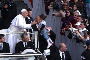 VATICAN CITY, VATICAN - MARCH 27:  Pope Francis greets a child from an open-air jeep, ahead of his first weekly general audience, in St Peter's Square on March 27, 2013 in Vatican City, Vatican.  (Photo by Franco Origlia/Getty Images)