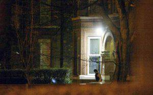 MANCHESTER, UNITED KINGDOM - JANUARY 14: A man leaves the apartment where a police officer was stabbed to death during the arrest of three terror suspects in a raid January 14, 2003 in Manchester, United Kingdom. Four other officers were injured, including one seriously. British authorities have confirmed that the raid is connected to the recent discovery of traces of the highly toxic poison ricin in a London apartment last week. (Photo by Alex Livesey/Getty Images)