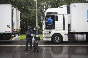 Police officers take part in a targeted police action against illegal immigration and human trafficking on the E40 highway in Thimister-Clermont in the direction of Liege on September 22, 2015. AFP PHOTO / BELGA / ANTHONY DEHEZ ***BELGIUM OUT*** (Photo credit should read ANTHONY DEHEZ/AFP/Getty Images)