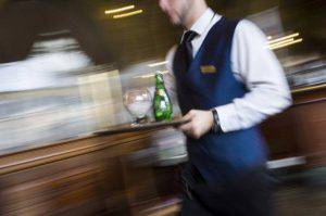 """A waiter works in a French brasserie """"Le Train Bleu"""", on April 11, 2013 in Paris. AFP PHOTO / FRED DUFOUR        (Photo credit should read FRED DUFOUR/AFP/Getty Images)"""
