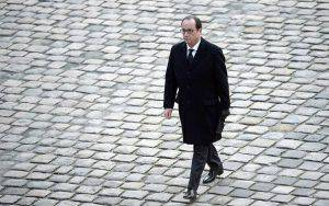 French President Francois Hollande walks past during a ceremony at the Hotel des Invalides in Paris on February 3, 2015, in honour of the nine French servicemen killed in an accident in Spain on January 26, 2015. The coffins of nine French military personnel, killed when a Greek F-16 fighter jet crashed at a Spanish base, were paraded to the sound of the funeral march into the courtyard of Les Invalides in Paris ahead of a national tribute led by President Francois Hollande. AFP PHOTO / STEPHANE DE SAKUTIN (Photo credit should read STEPHANE DE SAKUTIN/AFP/Getty Images)