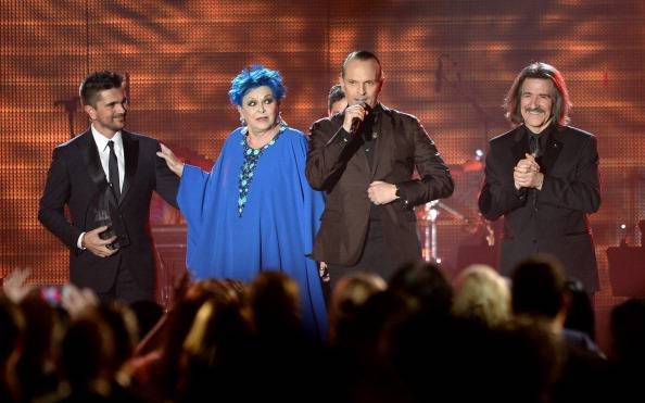 LAS VEGAS, NV - NOVEMBER 20:  (L-R) Recording artist Juanes, actress Lucia Bose, honoree Miguel Bose and Chairman of the Latin Recording Academy Luis Cobos onstage during the 2013 Latin Recording Academy Person Of The Year honoring Miguel Bose at the Mandalay Bay Convention Center on November 20, 2013 in Las Vegas, Nevada.  (Photo by Jason Merritt/Getty Images)