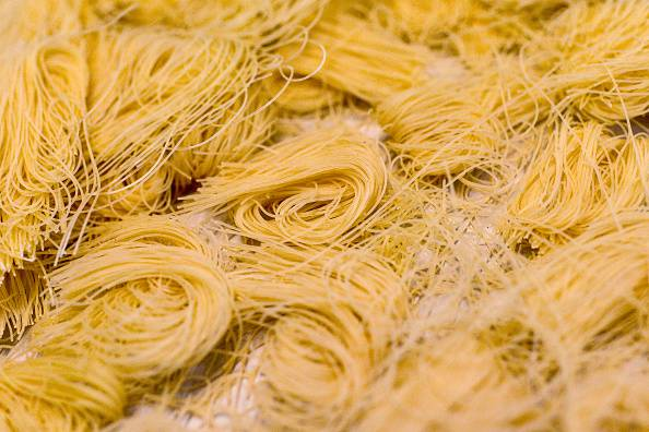 CALDES DE MONTBUI, SPAIN - OCTOBER 27:  Noodles are seeing before being packaged at Sanmarti factory on October 27, 2015 in Caldes de Montbui, Spain. The Sanmarti family has been involved in the production of pasta since 1700. Carles Sanmarti, the 8th generation descendent, still uses the original recipe using just amber durum wheat semolina, thermal mineral water and egg free. Sanmarti nowadays exports their pasta products to countries as diverse as the United States, China, Denmark and also to the United Kingdom, their largest foreign market.  (Photo by David Ramos/Getty Images)